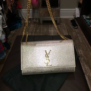 Yves Saint Laurent gold leather purse